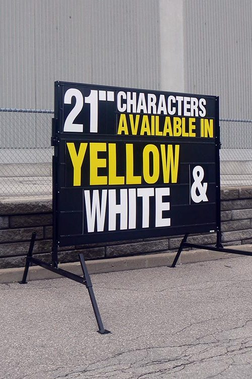 Black Sign Yellow & White Letters